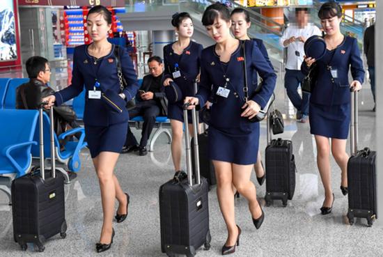 朝鲜空姐新版制服竟然是这样的太漂亮了图片